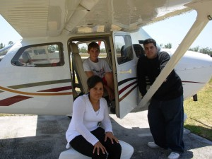 Jake Adams (in cockpit), Yuliana Rivera and Ricardo Pagan have registered for the aviation magnet program.