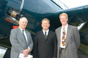 "Tri-State Warbird Museum founder David O'Maley, author and speaker James Bradley and Tri-State Pres. Paul Redlich pose before the TBM-3 Avenger dive-bomber. Bradley's second best-selling book, ""Flyboys,"" chronicles the story of George Herbert Walker Bush."