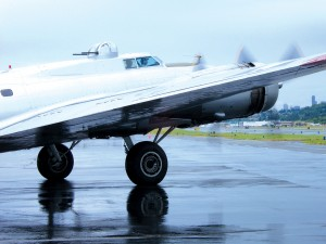 With its four 1,200-hp nine-cylinder Wright Cyclone radial engines thundering, Aluminum Overcast heads out between downpours for a flight over Seattle.