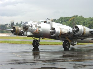"Aluminum Overcast turns off the taxiway to park in front of The Museum of Flight. Damaged two years ago when the main gear collapsed after landing at VNY, the Flying Fortress sports ""four fresh engines, propellers, and a lot of replaced skin""."