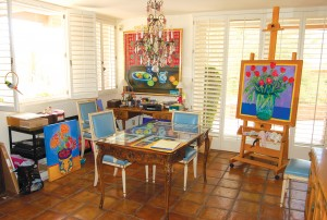 A former dining room now serves as a comfortable studio where Louise McCall does her painting.