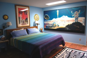 The artwork of Louise and Bob McCall is displayed throughout their beautiful home. This large painting of the surface on Mars can be found in one of the guest rooms.