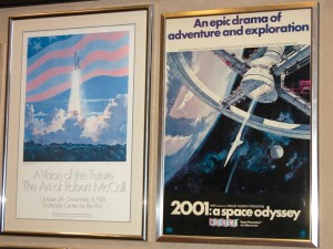 "These posters on display at the Industrial Commission Building in Phoenix illustrate the scope of Robert McCall's space art, from an operational shuttle to the futuristic space wheel in the movie ""2001: A Space Odyssey."""
