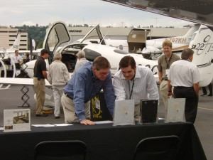 Two attendees check out aircraft specifications.