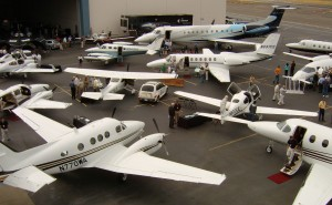An overview of the 2006 Saab Business Aircraft & Jet Preview at Boeing Field from the roof of a Galvin Flying hangar. Exhibitor booths and breakfast, lunch and afternoon wine and cheese were in the open hangar at upper left.
