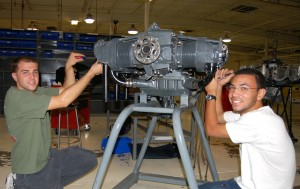 After overhauling the school's Lycoming engine, Joel Tricomo (left) and Mark Langan are in the process of reassembling the power plant.