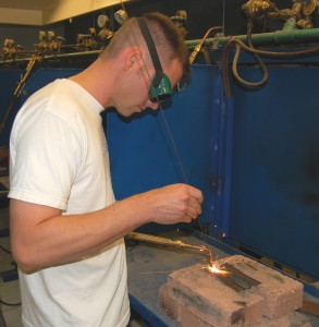 Student Peter Holcomb practices basic gas welding required by the airframe part of the A&P course.