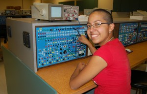 Nora Ramas uses the test equipment in the avionics lab as part of her airframe training.
