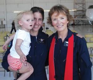 Flight Registered Nurse Hollie Seeley (left) next to Chaplain Amelie Buchanan after the morning ceremony.