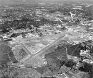 Seen here around 1960, the neighborhood is edging toward the field. Runway 1 would be extended to accommodate the arrival of the jet age, and Runway 32 was shut down and became a taxiway. Runway 24 (far right center) would be extended almost to the fence.