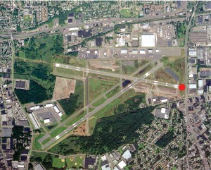 This recent photo of Teterboro shows the community at the gates of the airport. Runway 24 is barely 250 feet from a major U.S. highway and there's a warehouse where there was once an empty space across the road.