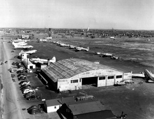Teterboro as it looked around 1947, filled with war surplus DC-3s and Curtiss Commandos converted to passenger service. In the background is a DC-4.
