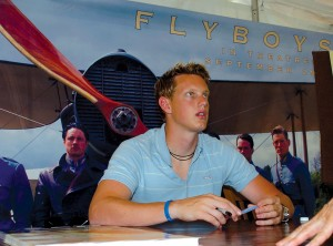 "Flyboys"" star David Ellison signs autographs at the Oshkosh premiere."