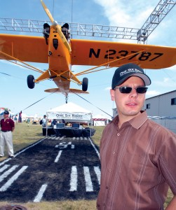 "Brian Terwilliger, producer and director of ""One Six Right,"" beneath a Piper Cub similar to one featured in the film. Terwilliger and the American Legend Aircraft Company presented two screenings of his 73-minute film."