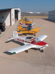 Outside IndUS Aviation's manufacturing hangar at Dallas Executive Airport (RBD), a robust lineup of T-211s wait for customer delivery.