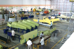 An international team of employees assembles airframes for the T-211 Thorpedo at the Bangalore headquarters of Taneja Aerospace & Aviation Limited.