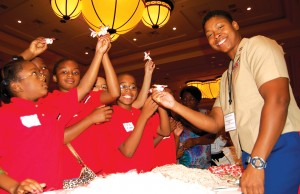 Marine Corps Captain Vernice Armour is a pilot of a Cobra helicopter gunship and the first African-American female combat pilot in the military. She showed youth, such as this group from Avondale, Ariz., how to build airplanes using candy and rubber bands