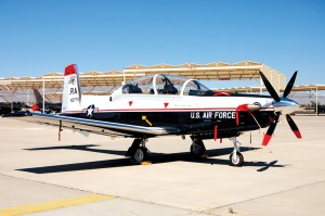 This T-6 Texan II, a turboprop built by Raytheon, is used to train Air Force pilots today. It was part of a special aircraft display set up for the Tuskegee Airmen's visit to Luke AFB. They trained in the original AT-6 Texan at Tuskegee Army Airfield.