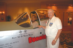 L to R: Alex Anderson got to check out a mock-up of Roscoe Brown's P-51 with the help of Tuskegee Airman Lt. Col. George Hardy.