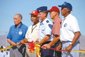 L to R: Lt. Col. Lee Archer, Lt. Col. Robert Ashby, Col. Derek Rydholm (commander of the Air Force Reserve Command's 944th Fighter Wing), Master Sgt. James Sheppard and Tech Sgt. George Watson helped to cut the ribbon during the dedication ceremony.