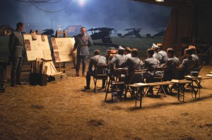 Captain Thenault (Jean Reno) briefs the squadron before a mission.