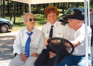 A Highground volunteer gives Dorothy Swain Lewis and Cholene Espinoza a ride to the top of the Highground.