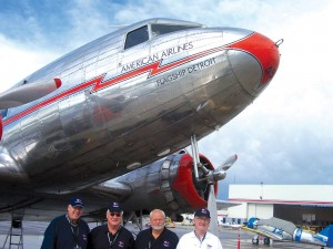 An American Airlines DC-3 brought by, L to R, Flagship Detroit Foundation Pres George Dennis and Capts Cal Moreland, Ron Tallent and Stephen Jacobson won the Morgan Adams Concours d'Elegance Peoples Choice, and Brett Derosier Memorial-Best of Show award.