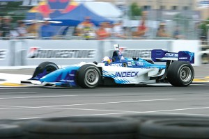 A.J. Allmendinger zips past signage provided by Bridgestone, a title sponsor of the series and newfound partner for the 2006 Grand Prix of Denver.