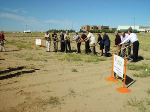 Michael Buehner-Coldrey of Amjet led investors and Adams County commissioners in breaking ground for a new 29,000-square-foot hangar at Front Range Airport.
