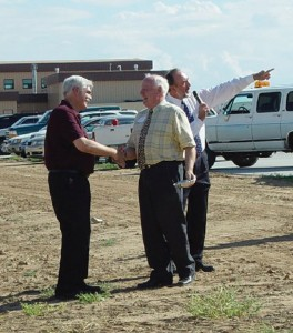 Michael Buehner-Coldrey (center) greets guests at the ribbon-cutting for his company's new 27,000-square-foot hangar.