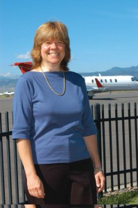 Karen Martin, by the runway at Jefferson County Airport, is president of FlightTrak, Inc. The company provides FT Scheduler, flight scheduling software that is used by pilots, dispatchers and schedulers.