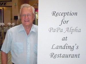 "A large sign greeted ""Papa Alpha"" Phil Aune in the lobby of the Airtel Plaza Hotel."