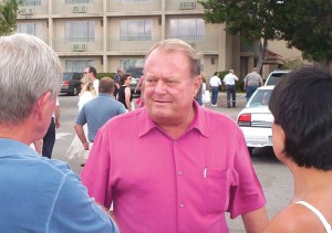 Jim Dunn (center), owner of the Airtel Plaza Hotel, chats with some guests as others head back into the Landing's Restaurant after the flyovers.