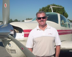 Brian Dixon, owner of ScottT's Shirts & Things, flew into the picnic in his V35B Beech Bonanza.