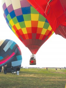 When balloons are ascending en masse, pilots typically ascend at less than 200 feet per minute, or about two miles per hour. The pilots who are above must watch for rising balloons, since the pilot below can't see through the top of the balloon.