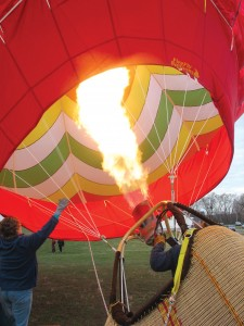Mary Beth Young holds open the throat of the balloon while Dick Young heats the air with a propane burner. The burner emits 17 million BTUs per hour—roughly equivalent to the heat output of about 170 home furnaces.