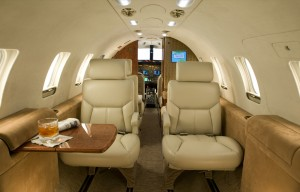 Kate Woolstenhulme custom designs each aircraft interior to the highest standards, with fine touches like in-flight game tables and a unique color blend based on each client's tastes.