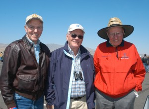 National Aviation Hall of Fame enshrinees Joe Engle, Neil Armstrong and Bob Hoover enjoy the desert sun on the ramp at Reno.