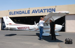 Certified flight instructor Carl Brandenberg shows Glendale Aviation student Wolf Sheuemann what to look for while inspecting the aircraft prior to making a flight.