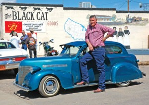 Ernie Adams shows off his 1939 Chevy at the Route 66 Fun Run stop in Seligman, Ariz.