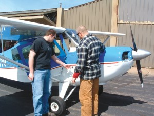 John Chmiel, manager of Wausau Flying Service, shares preflight inspection duties with fellow flight instructor Adam Weiland. The National Association of Flight Instructors recently named Chmiel  a master certified flight instructor.