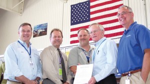 L to R: Rick Adam celebrates the A500's production certificate with Ron May (FAA Denver aircraft certification office manager), Kurt Krumlauf (production certification board chair), Darrel Watson (Adam VP, quality assurance) and Joe Walker (president).