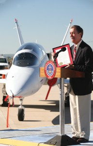Standing in front of Aviation Technology Group's Javelin, Governor Owens proclaimed August 29 Spreading Wings Day in Colorado.