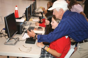 Walt Barbo works with students on the simulators.