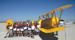 Students from American Academy got an up-close look at Mike Baldwin's Stearman.