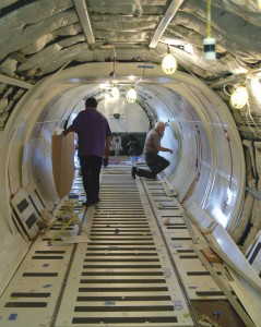 The Straight Flight Conversion crew completes the installation of e-class cargo liner configuration.