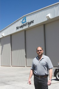 Ernie Smith, co-owner of Straight Flight, in front of the company, located at Centennial Airport.