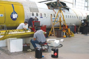 Stan Mounce and his staff of 16 mechanics work diligently on the Fokker 50 conversion.