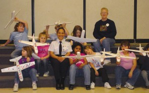 Becky Roman-Amador, a captain in the PPLI program and a regional airline first officer, talked to a Girl Scout troop as part of her leadership activities.