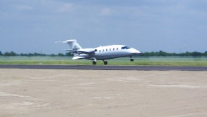 Ron Henriksen lands his twin-engine Piaggio P-180 Avanti August 6, becoming the first pilot to land at his new Houston Executive Airport.